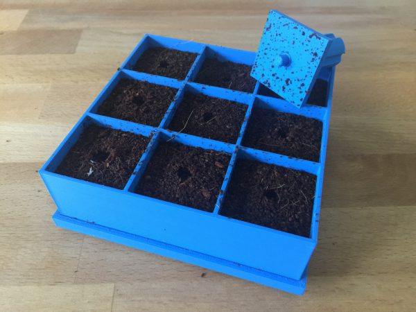 Seed germination tray with removable base and stamp